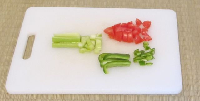 chopping vegetables for Greek salad