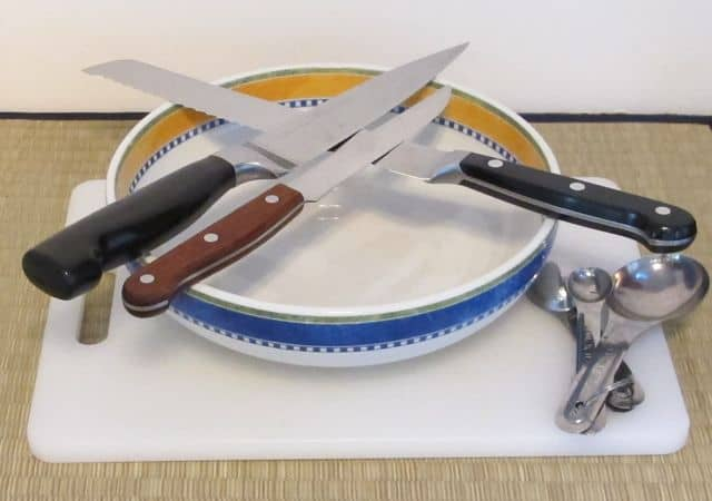 equipment and utensils for making Greek salad, serrated edge knives