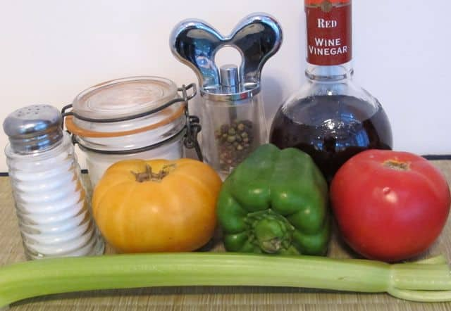 ingredients for Greek salad, tomatoes, green pepper, celery, vinegar, sugar