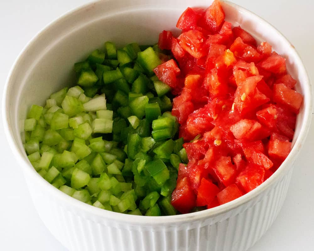 bowl of chopped vegetables ready to be stirred for the salad