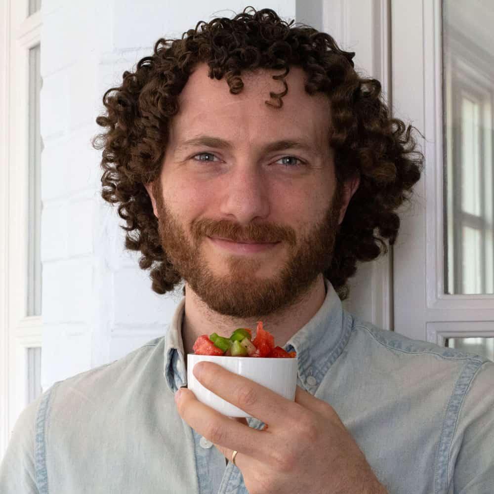 My son Liam holding a ramekin of salad