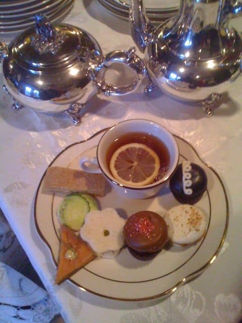 silver tea service and sweets, cupcakes and macarons