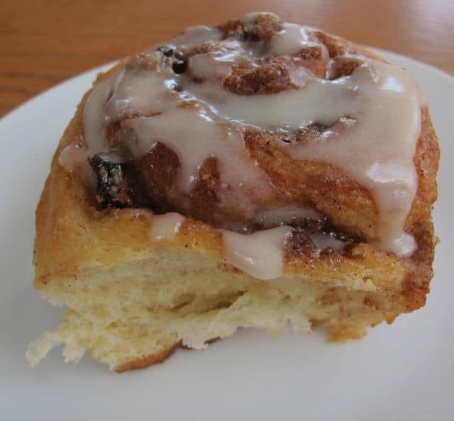 a cinnamon roll with confectioners sugar glaze