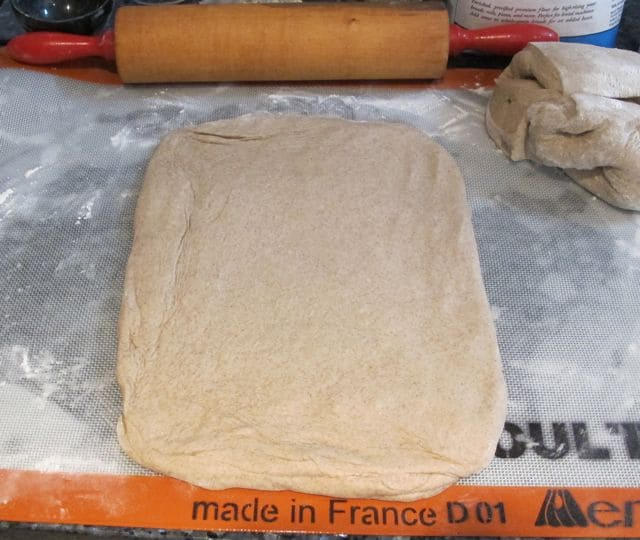 stretching bread dough