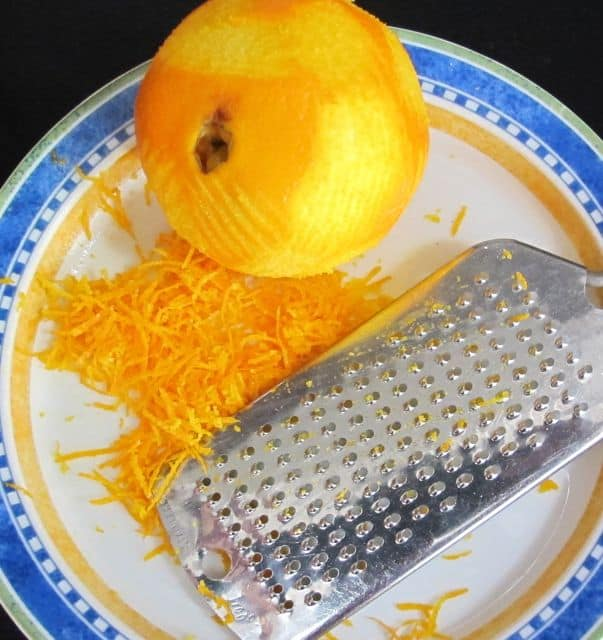 grating orange rind for glazed chocolate cupcakes