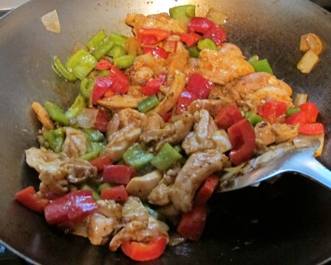 adding peppers to stir fry