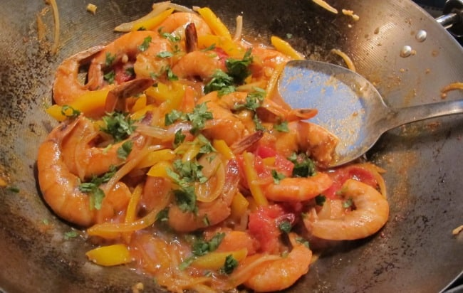 stir fried shrimp with vegetables and rum sauce finished in wok