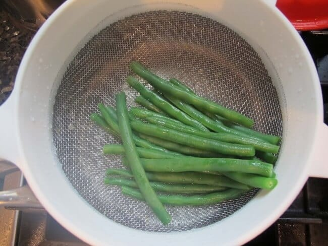 after you parboil or blanch beans, you should drain and rinse them to stop the cooking process