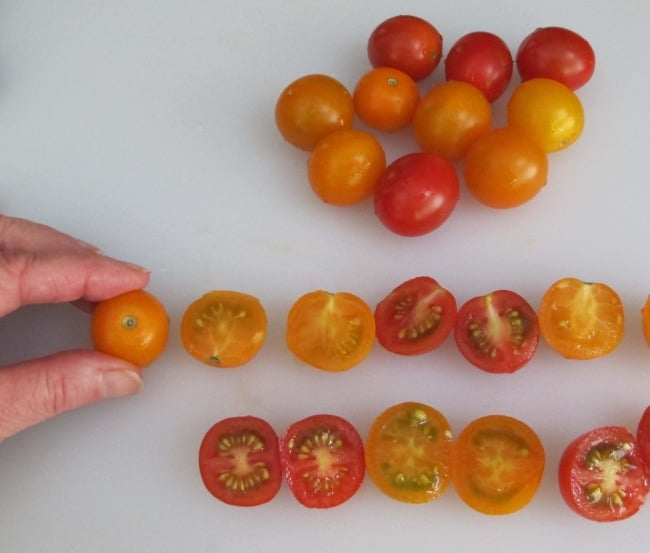cutting cherry tomatoes with serrated knife