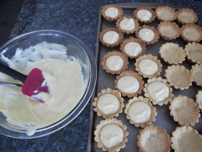 putting pastry cream in tartlet shells