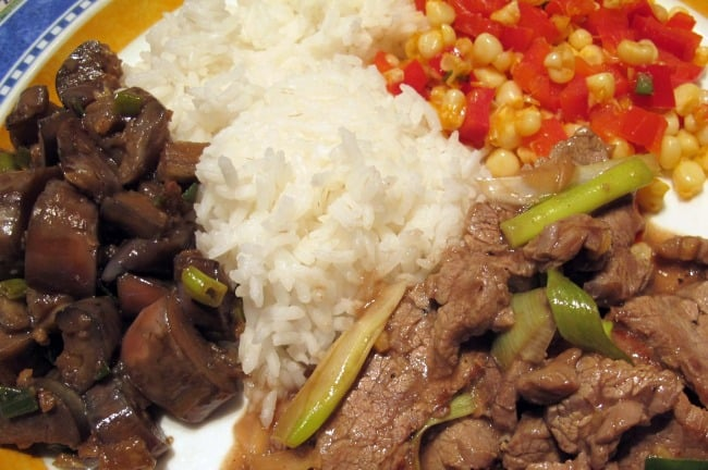 stir-fried ginger beef, corn and red pepper, and garlic eggplant