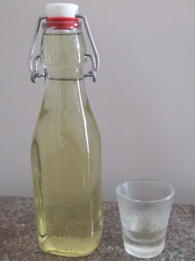 pouring drink of limoncello