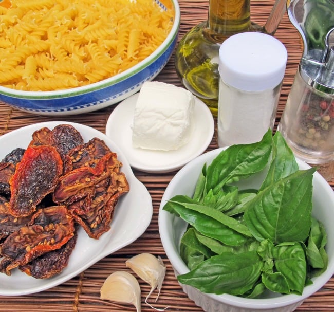 Ingredients for basil, sun-dried tomato and goat cheese pasta