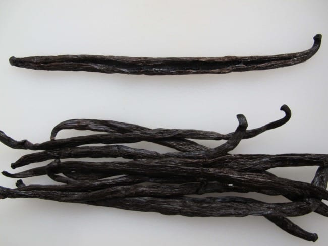 cutting vanilla bean to make homemade extract