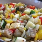 Cooking the zucchini, yellow squash, eggplant, garlic, onions, and bell pepper for Easy Winter Ratatouille