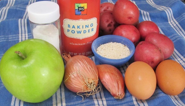 ingredients for potato pancakes or latkes with shallots and apples