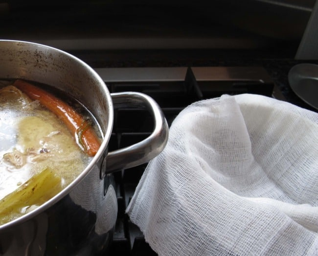 straining chicken soup