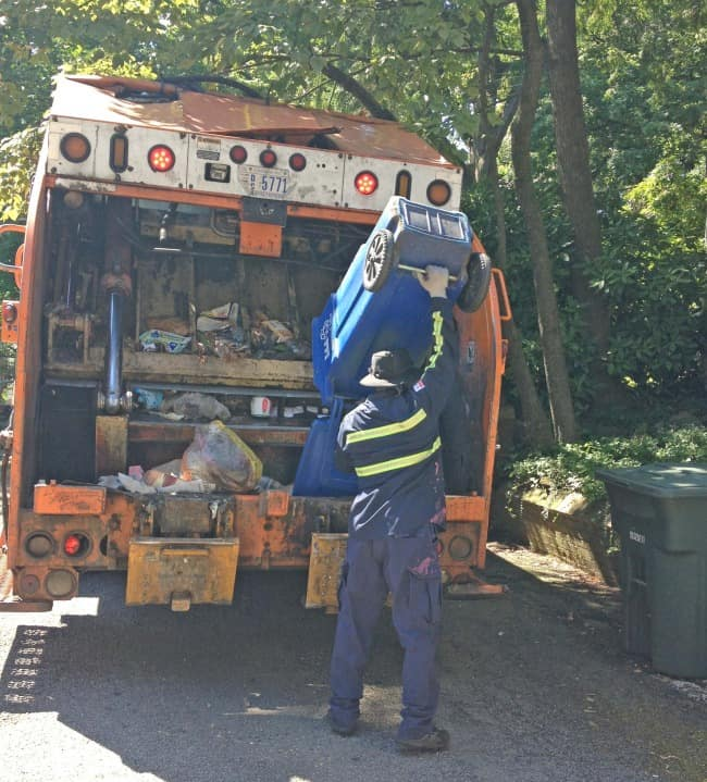 food wasted thrown away in garbage truck