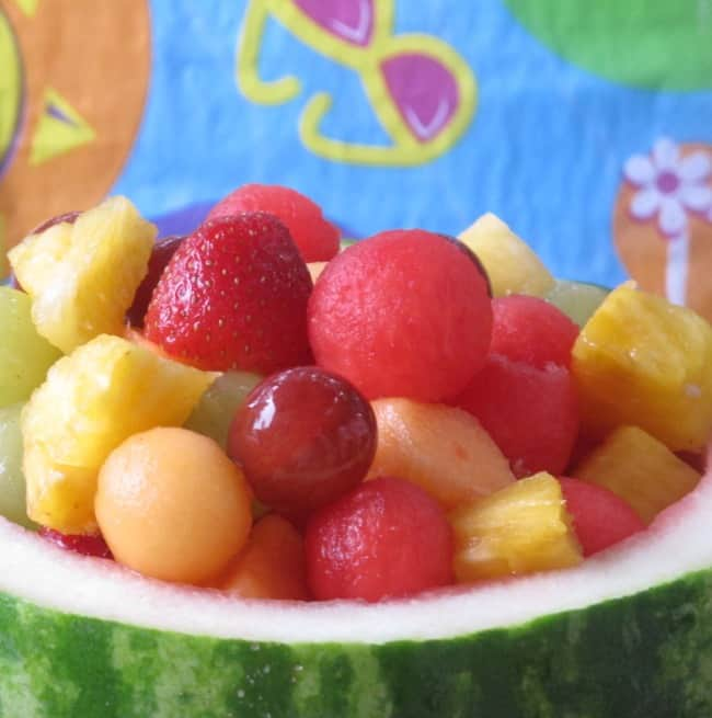 fruit salad inside watermelon bowl