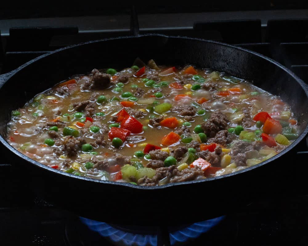 meat and frozen vegetables added to the single serving shepherds pie filling
