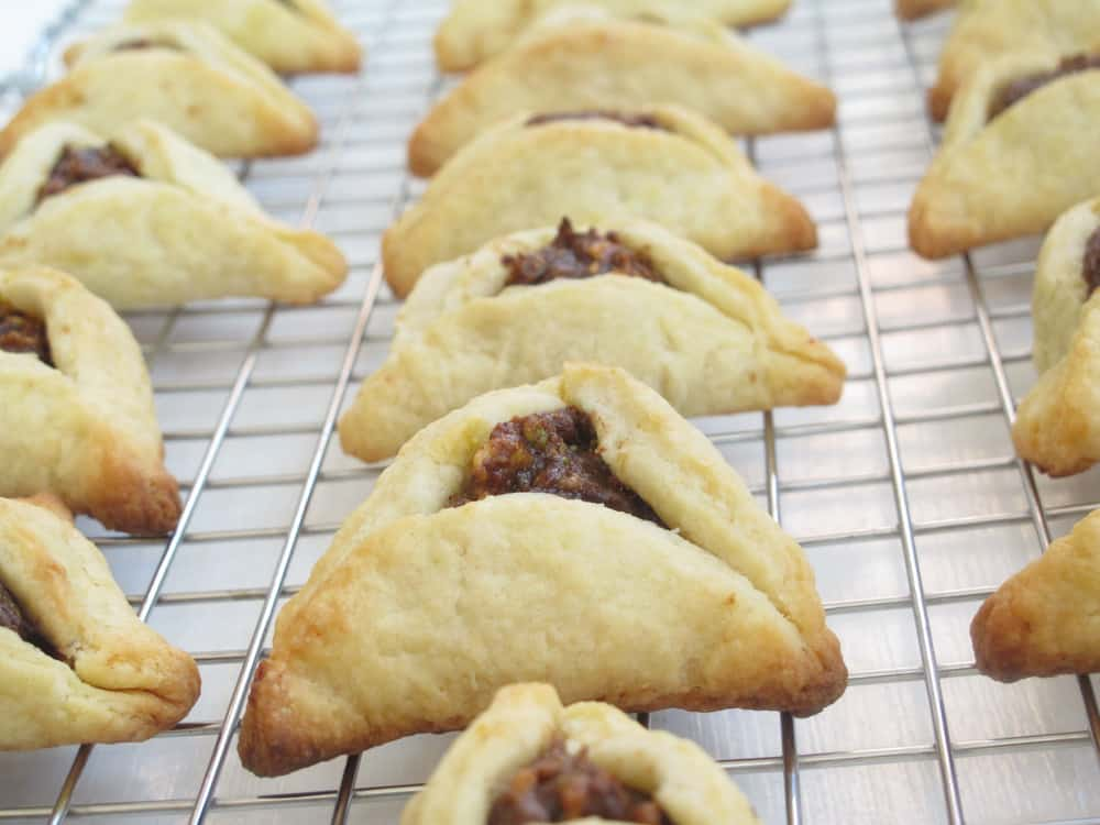 Hamantaschen with a fragrant chocolate, pistachio, and orange filling. | Mother Would Know