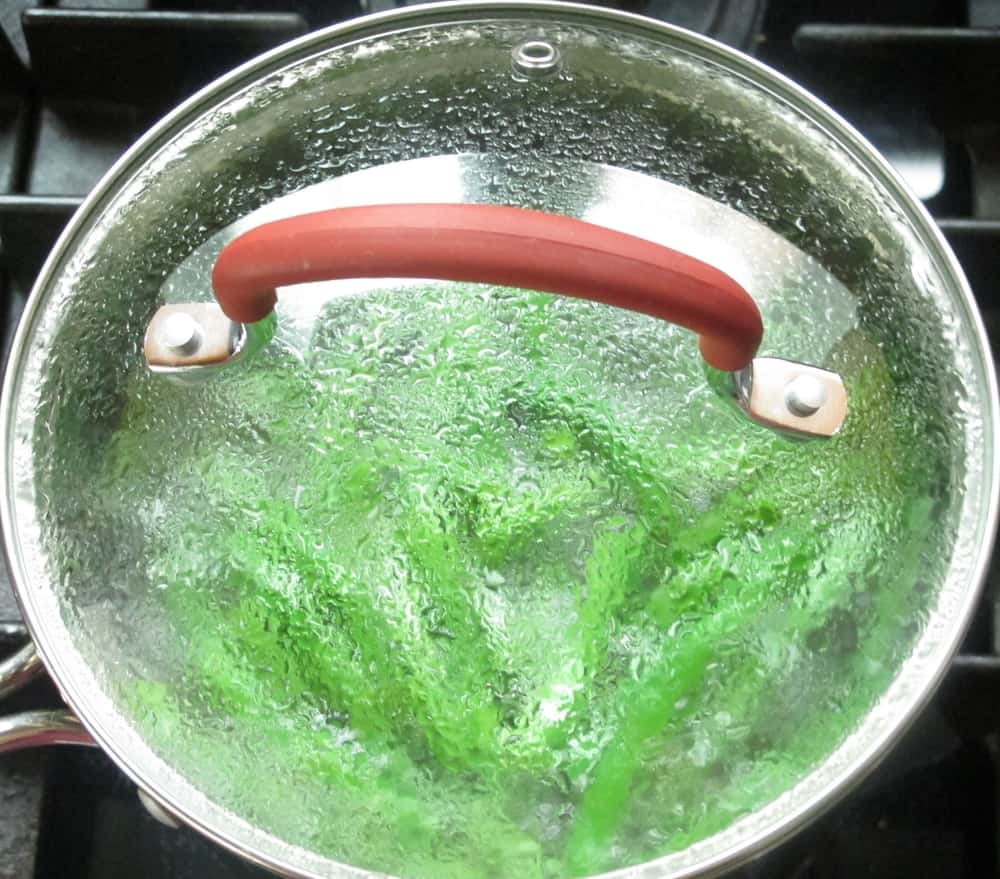 blanching green beans in a pot