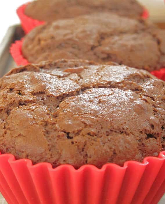 Jumbo chocolate muffins are a great treat that carries well, to picnics, pot lucks and games.