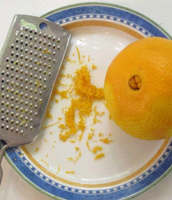 Zesting an orange for jumbo chocolate muffins.