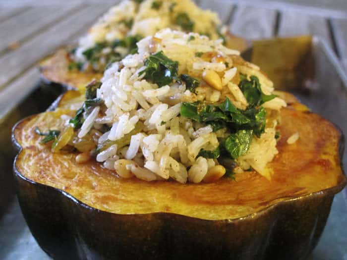 Moroccan-style acorn squash is simple to make and nutritious, with a kale, rice and nut stuffing.