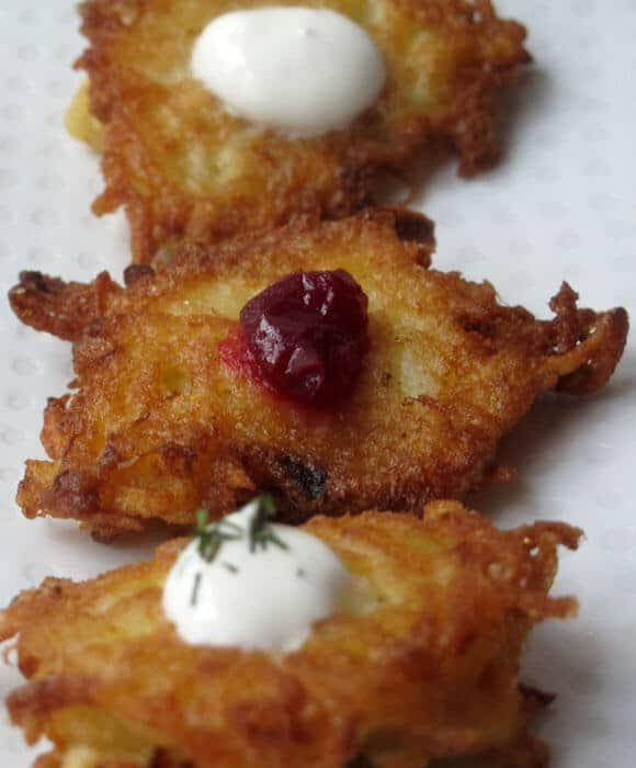 Bite-sized potato latkes are a perfect appetizer for the Jewish holiday of Chanukah or any other time.