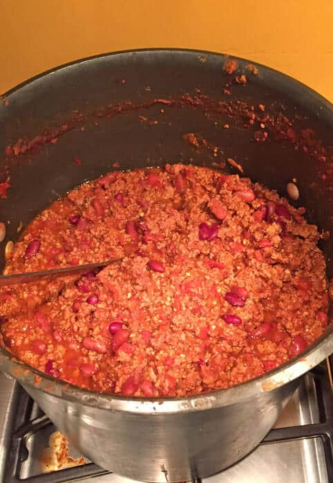 chili with meat cooking on the stove