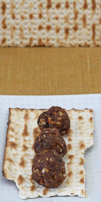 Charoset balls on matzo for Passover.