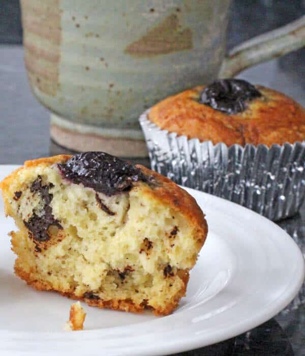 Sour cream muffins with chocolate chunks and cherry, plus a cup of coffee
