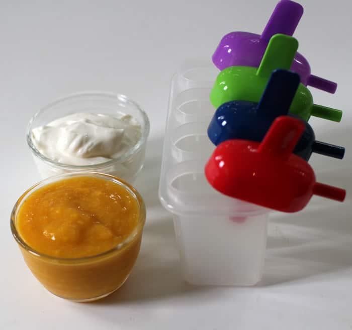 Super easy and healthy mango, peach and yogurt popsicles