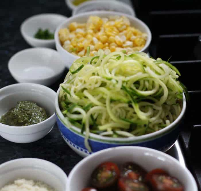 mise en place for spiralized zucchini with pesto, tomatoes, and corn
