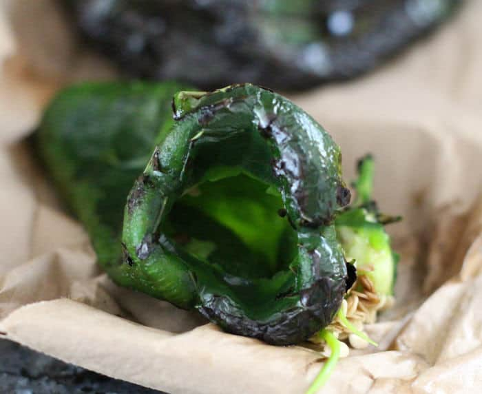 cutting and de-seeding a roasted poblano pepper