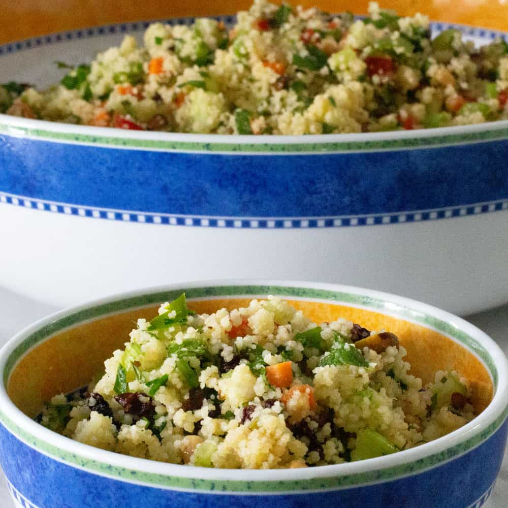 minty couscous in small bowl in front of larger bowl