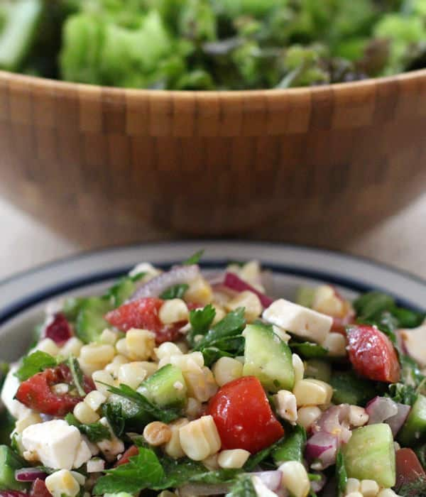 Tangy Vegetable Salad with Feta. Takes a few simple ingredients and elevates them to an addicting side or main dish. | Mother Would Know
