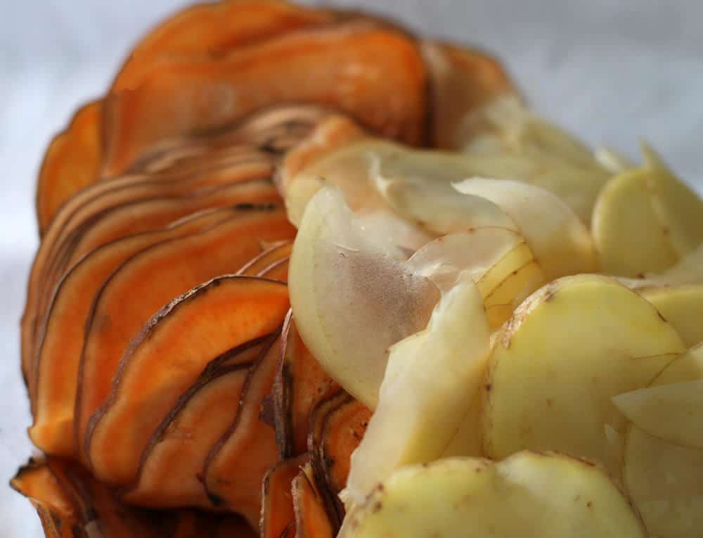 Sliced potatoes for No Fuss Potato Casserole | Mother Would Know