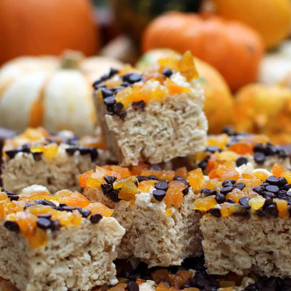 Rice krispy treats topped with dried apricots and mini chocolate chips | Mother Would Know