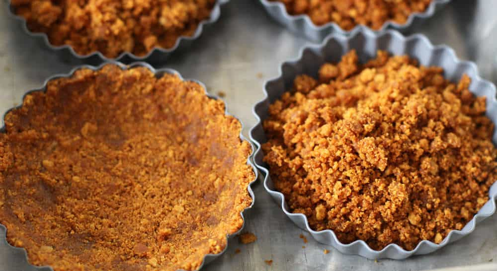 Forming the shells for mini tarts is easy with gingersnaps and melted butter.