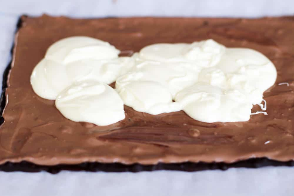 The third and final layer of triple layer chocolate bark, poured.