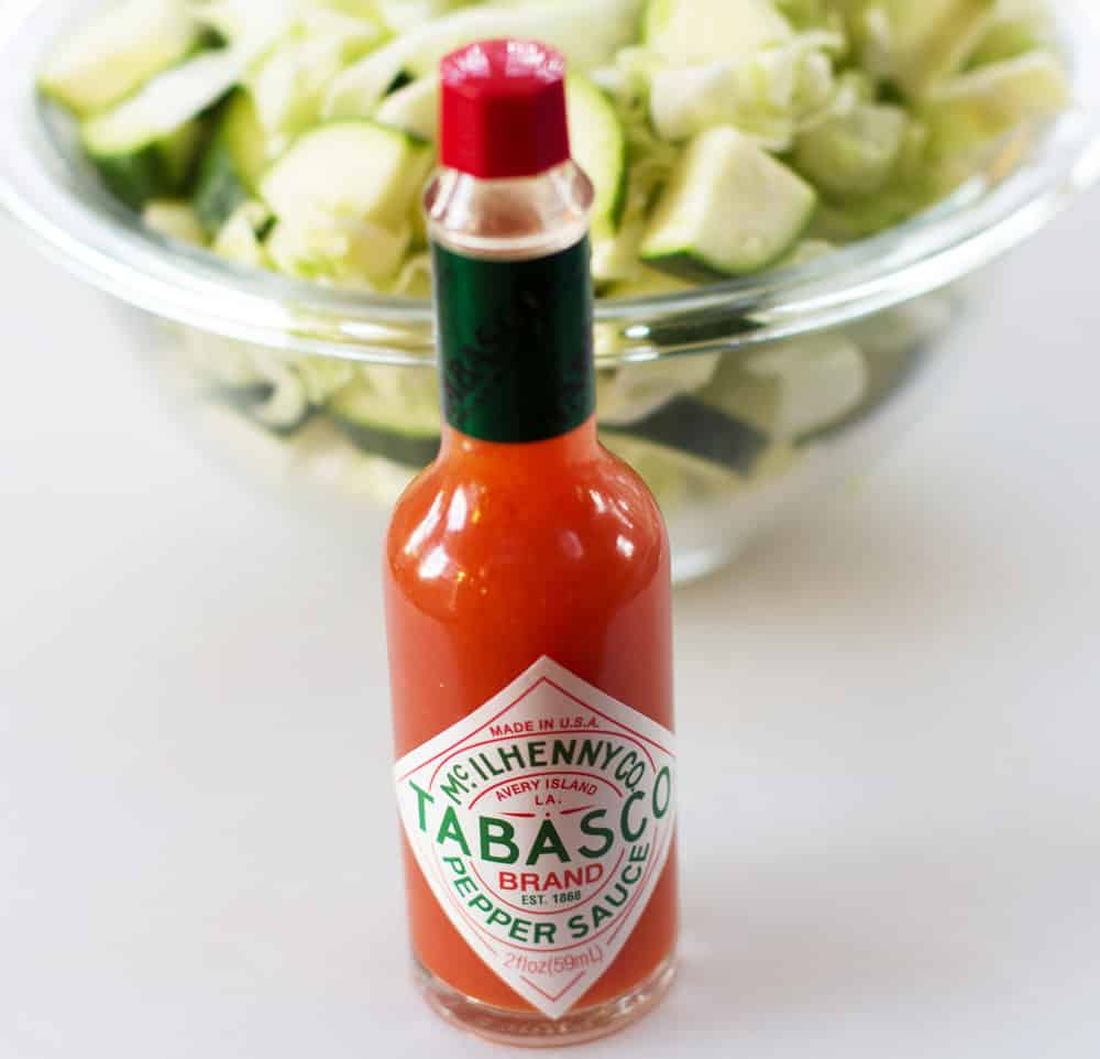 Tabasco or other hot sauce is a twist on the traditional use of red pepper flakes