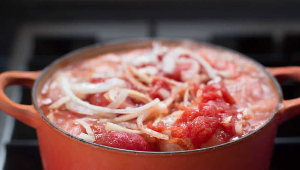 Tomato sauce on top of Jewish stuffed cabbage rolls, ready to cook.