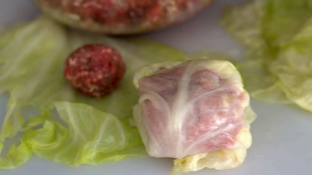 It's easy to roll the meatballs for stuffed cabbage.