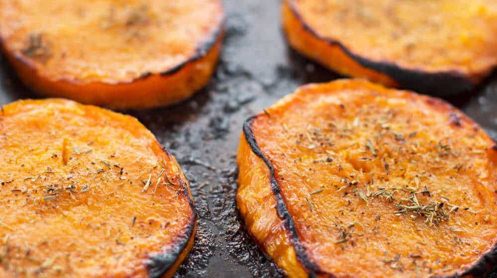 Maple Roasted Butternut Squash Slices with Thyme on the pan | Mother Would Know