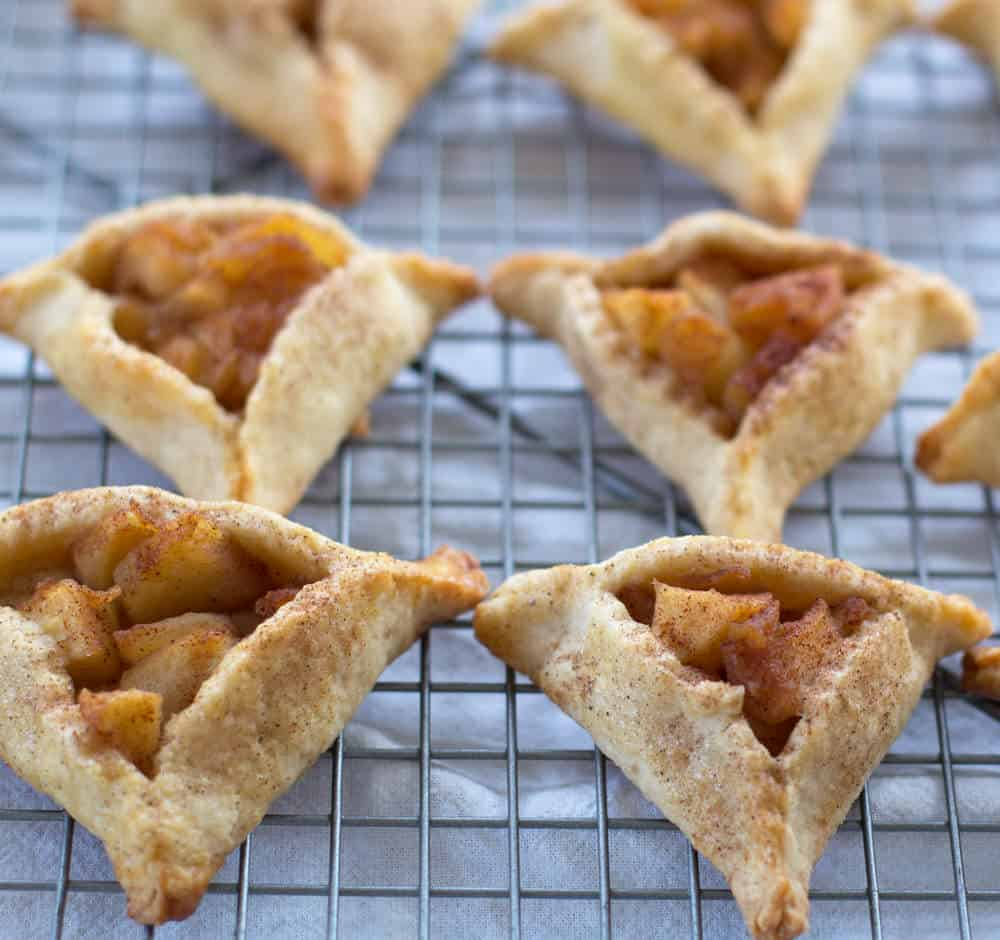 Apple pie hamataschen cooling on a rack | Mother Would Know