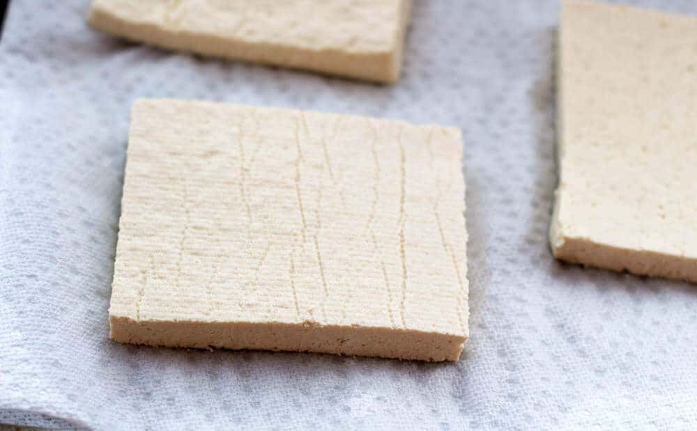 For crispy baked tofu, cut the block into three slices before drying it. | Mother Would Know