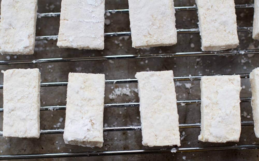 Tofu drying tossed with cornstarch. | Mother Would Know