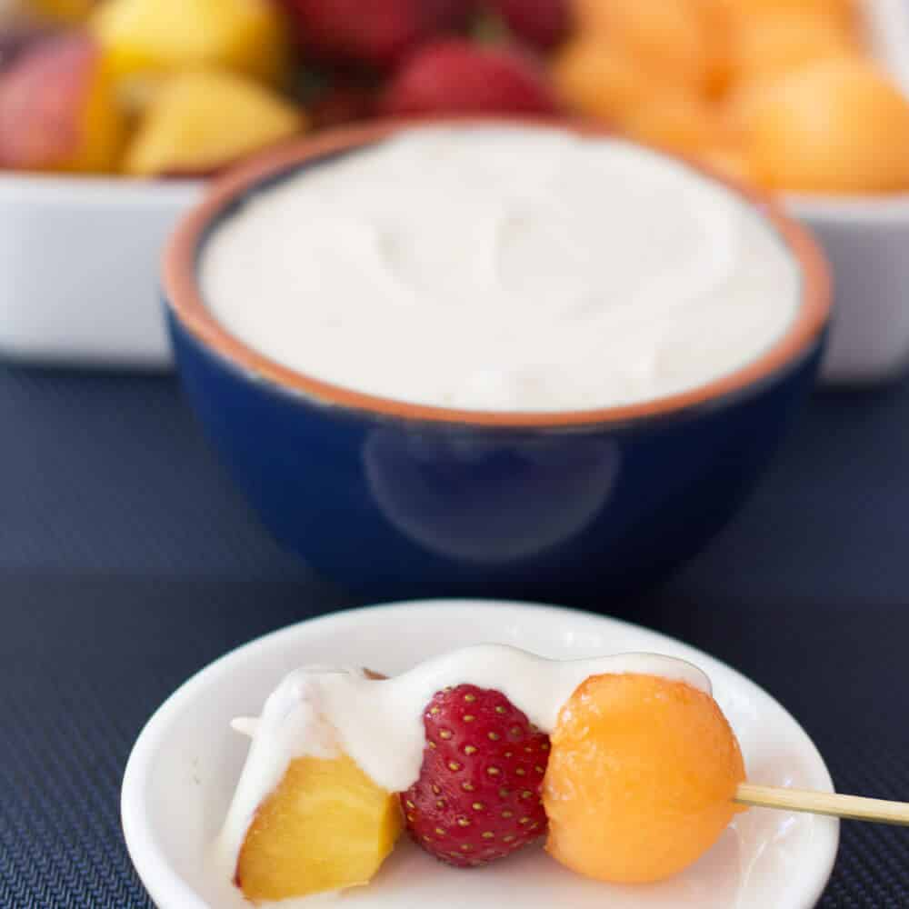 Put the fruit on a fork or on a skewer, just make sure to have on hand this delicious 3 Ingredient Sweet Creamy Summer Fruit Dip. | Mother Would Know